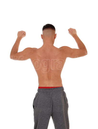 Shirtless man standing from the back