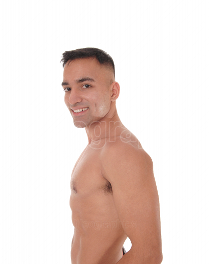 Shirtless man standing waist up in profile and smiling