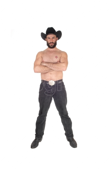 Shirtless man with a cowboy hat an his arms crossed