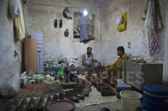 Shoe repair man from Islamabad
