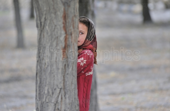 Shy and young girl from Shimshal village.