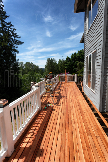 Side view of a home outdoor wooden deck being completely remodel
