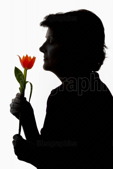 Silhouette woman and tulip