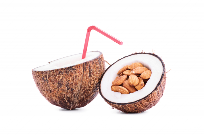 Sliced coconut filled with milk and almonds