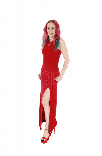 Slim woman standing in a red evening dress