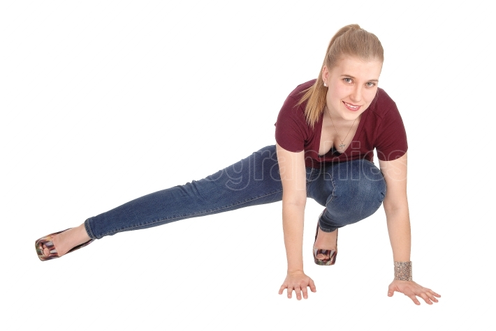 Slim young woman crouching on floor
