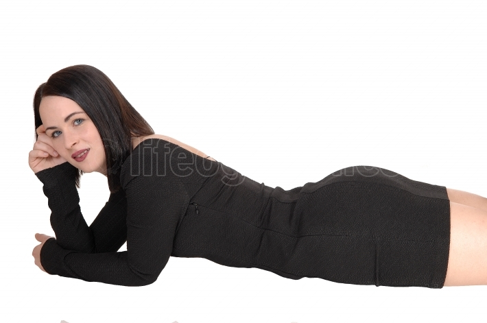 Slim young woman lying on stomach on floor