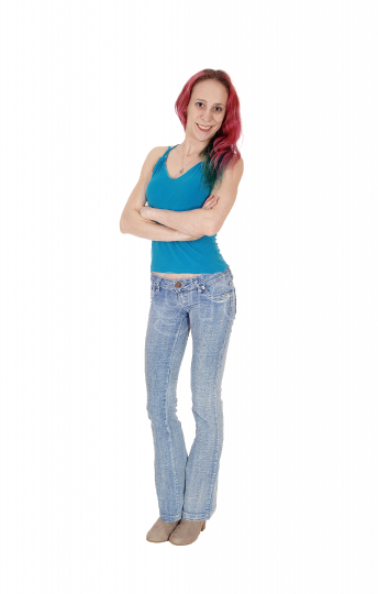Slim young woman standing in profile in jeans