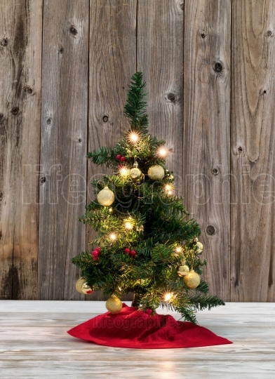 Small Christmas tree decoration on rustic wooden background