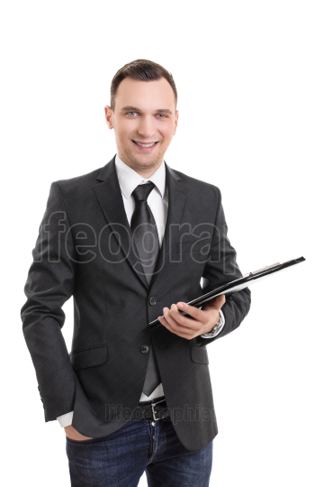 Smiling attractive young businessman holding a clipboard