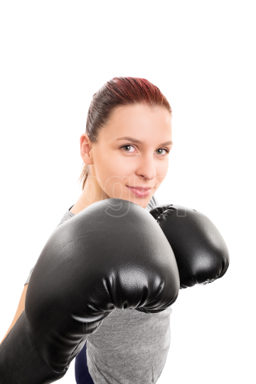 Smiling beautiful young girl with boxing gloves