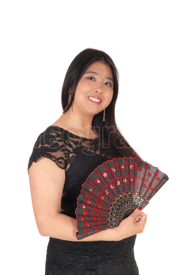Smiling Chinese woman in a black dress and fan
