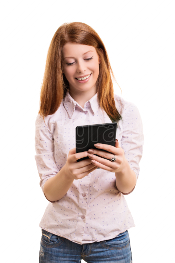 Smiling female student holding a tablet