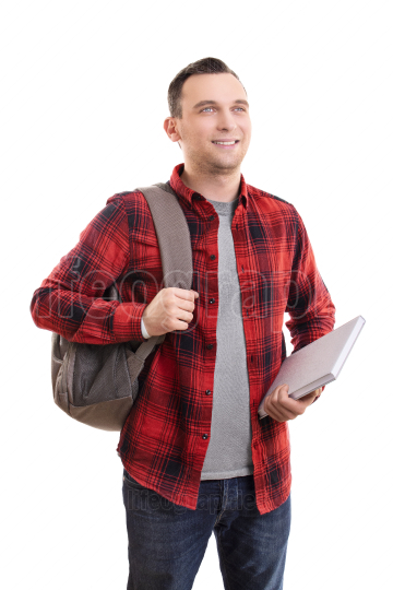 Smiling male student in casual clothing with backpack and notebo