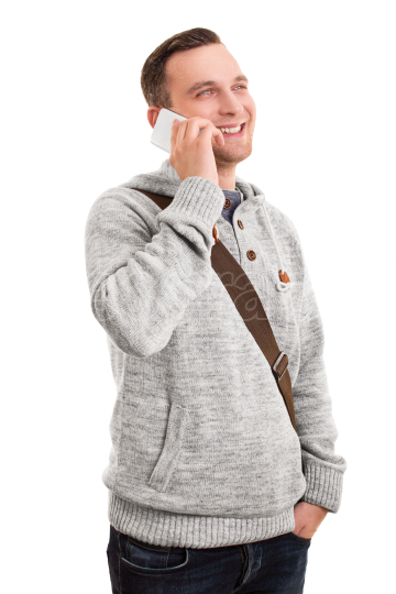 Smiling male student talking on the phone