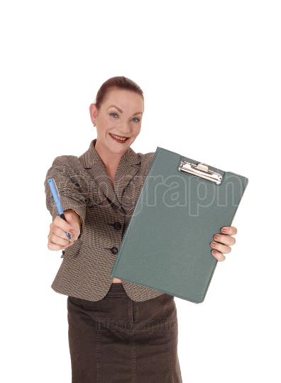 Smiling woman holding her clipboard and pen