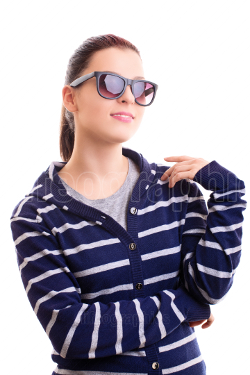 Smiling young girl in casual clothes with sunglasses