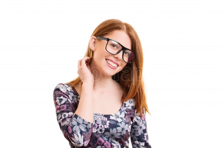 Smiling young girl with glasses