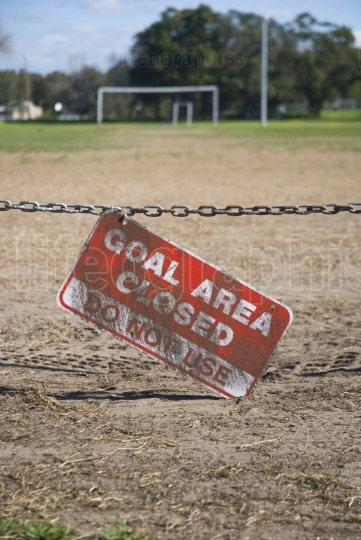 "Soccer goal with sign saying "" closed"""
