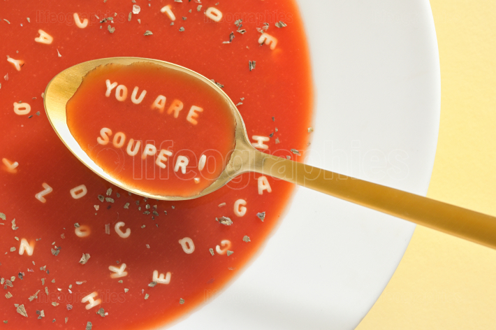 Soup With Letter Noodles On Spoon