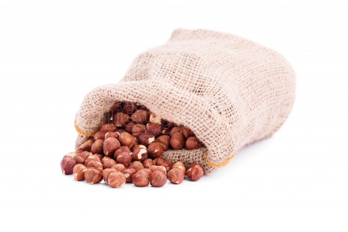 Spilled sack of hazelnuts