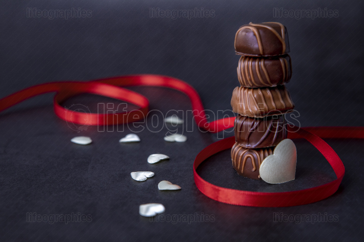 Stack of Chocolate candy and red ribbon