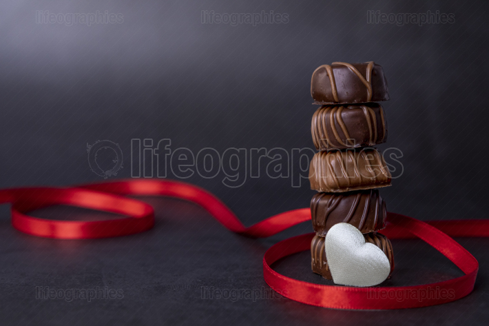 Stack of pralines chocolate for Valentines day