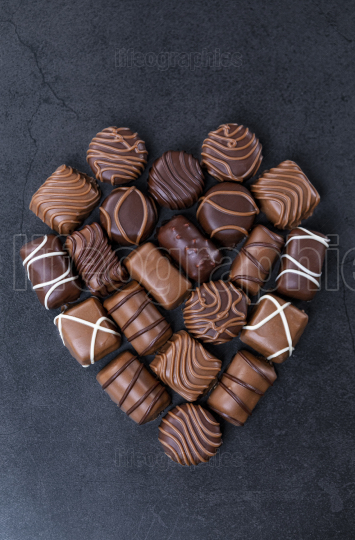 Stack of pralines chocolateshape a heart for Valentines day