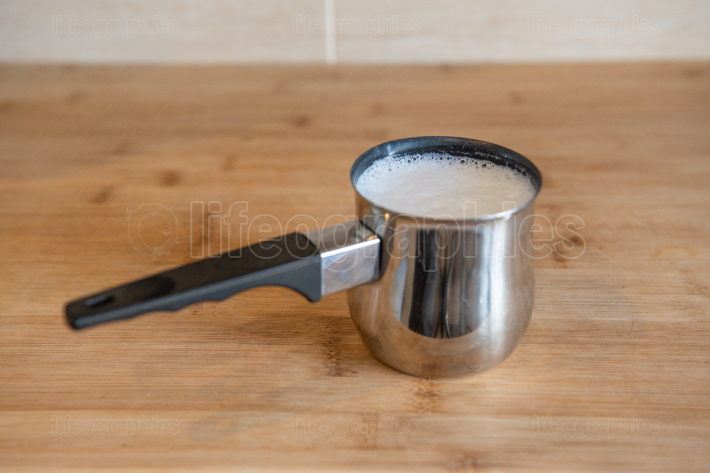 Stainless Steel Milk Pitcher with whipped milk