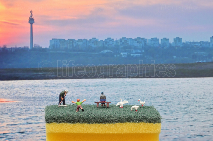 Stay home Miniature Toy Figures and Galati City Landscape