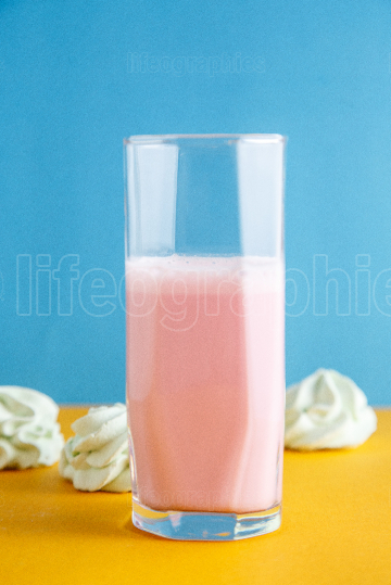 Strawberry milkshake on a colored background