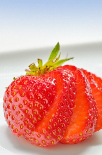 Strawberry slices on white background