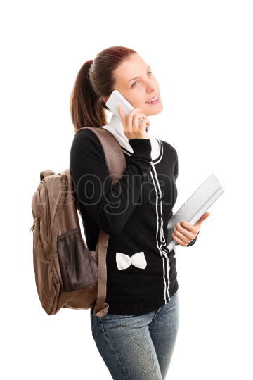 Student with backpack and notepad talking on the phone