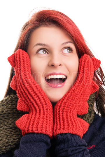 Surprised young girl in winter clothes