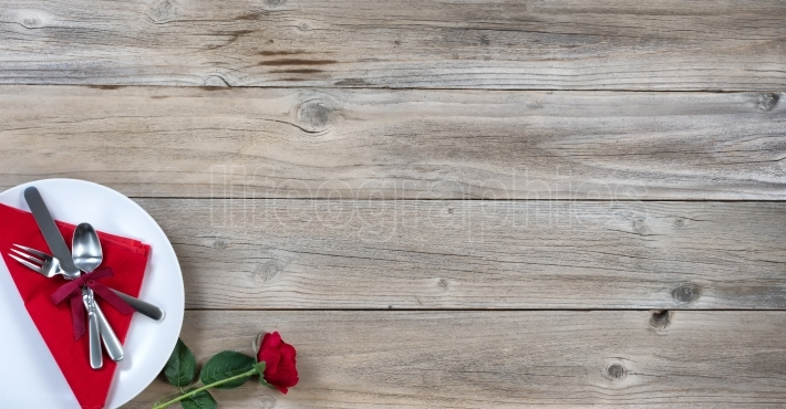 Table setting for Valentines dinner on rustic wood