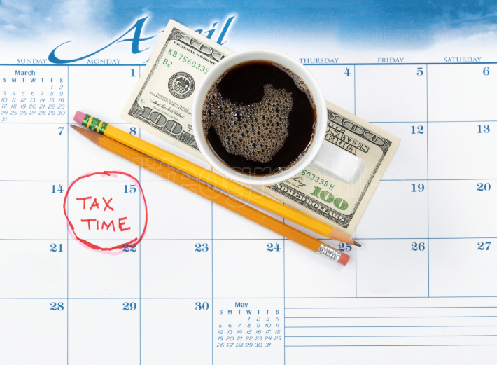 Tax due date marked in red on calendar with pencils and coffee