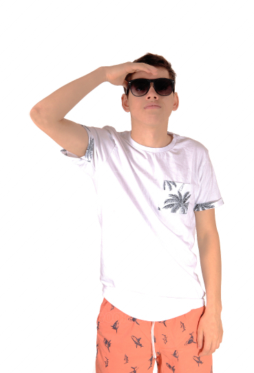 Teen boy standing in summer outfit and sunglasses