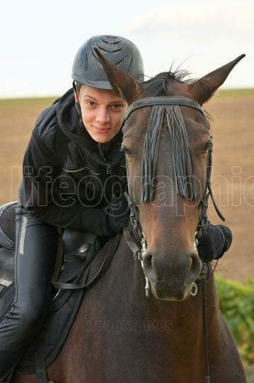 Teenage boy with a horse