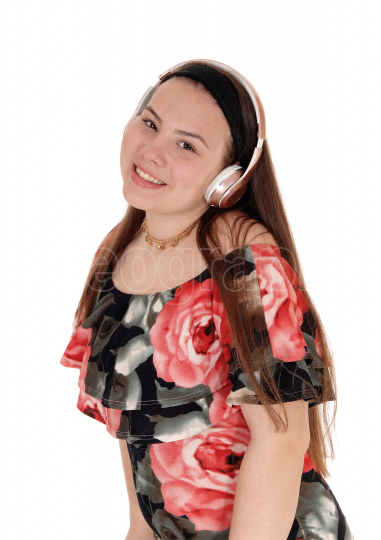 Teenager girl listening to music from her earphone