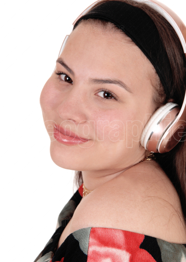 Teenager girl listening to music with her earphone