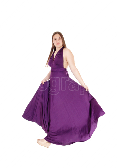 Teenager girl standing in her long burgundy prom dress