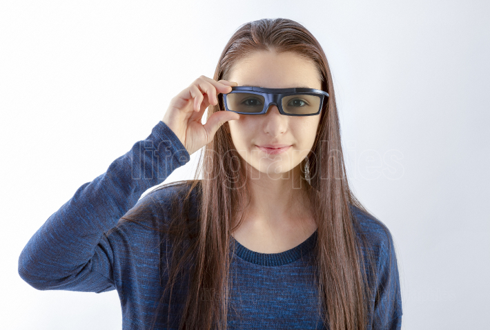 Teenager girl with 3d glasses looking at camera