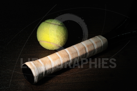 Tennis racket isolated on black background with tennis ball