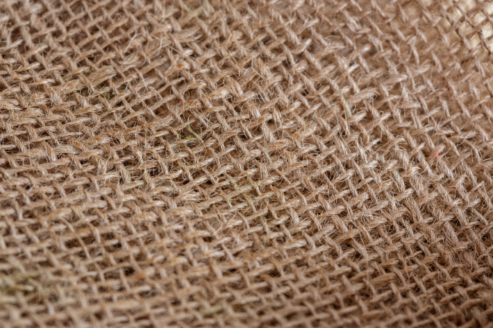 Texture of beige brown canvas fabric close