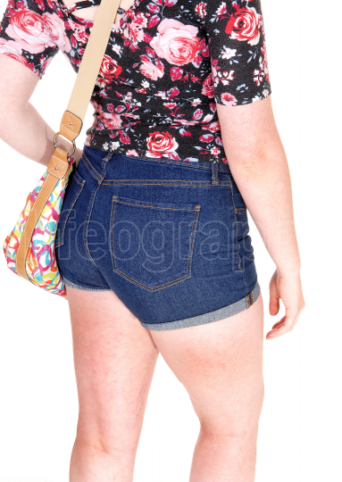 The backside of a young woman in shorts