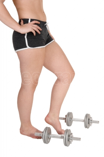 The bottom part of a woman with some dumbbells