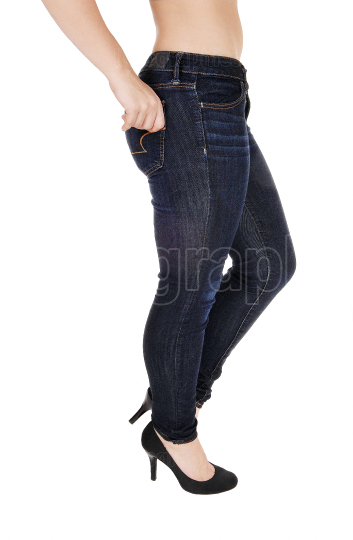 The buttocks legs and hip of a woman in jeans