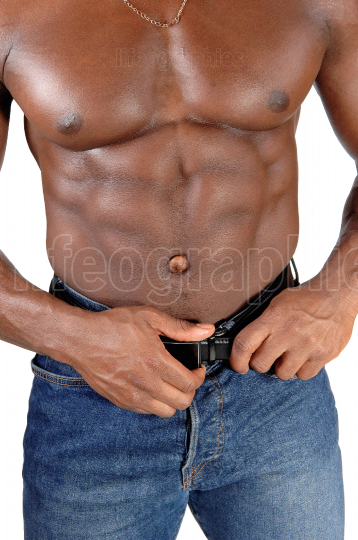The close up image of the torso of a black man bodybuilder