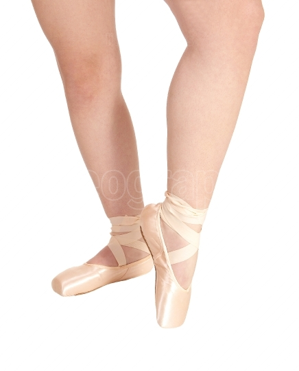 The legs of a ballerina with her pink ballet shoes