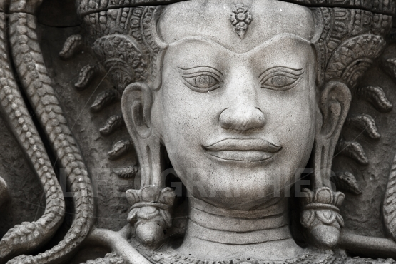 The stone face of the khmer king on the wall of  Temple,black